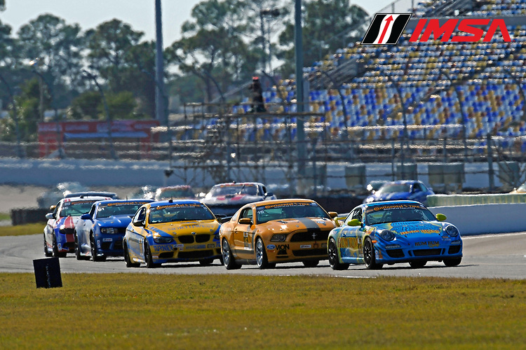 22-24 January, 2014, Daytona Beach, Florida USA<br /> #13, Porsche, 997, GS, Matt Plumb, Nick Longhi leads the field into the  the road course during the opening laps.<br /> ©2014, F. Peirce Williams<br /> LAT Photo USA