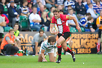 20120803 Copyright onEdition 2012©.Free for editorial use image, please credit: onEdition.Steve Hamilton of London Welsh accelerates past Alex Gray of London Irish at The Recreation Ground, Bath in the Final round of The J.P. Morgan Asset Management Premiership Rugby 7s Series...The J.P. Morgan Asset Management Premiership Rugby 7s Series kicked off again for the third season on Friday 13th July at The Stoop, Twickenham with Pool B being played at Edgeley Park, Stockport on Friday, 20th July, Pool C at Kingsholm Gloucester on Thursday, 26th July and the Final being played at The Recreation Ground, Bath on Friday 3rd August. The innovative tournament, which involves all 12 Premiership Rugby clubs, offers a fantastic platform for some of the country's finest young athletes to be exposed to the excitement, pressures and skills required to compete at an elite level...The 12 Premiership Rugby clubs are divided into three groups for the tournament, with the winner and runner up of each regional event going through to the Final. There are six games each evening, with each match consisting of two 7 minute halves with a 2 minute break at half time...For additional images please go to: http://www.w-w-i.com/jp_morgan_premiership_sevens/..For press contacts contact: Beth Begg at brandRapport on D: +44 (0)20 7932 5813 M: +44 (0)7900 88231 E: BBegg@brand-rapport.com..If you require a higher resolution image or you have any other onEdition photographic enquiries, please contact onEdition on 0845 900 2 900 or email info@onEdition.com.This image is copyright the onEdition 2012©..This image has been supplied by onEdition and must be credited onEdition. The author is asserting his full Moral rights in relation to the publication of this image. Rights for onward transmission of any image or file is not granted or implied. Changing or deleting Copyright information is illegal as specified in the Copyright, Design and Patents Act 1988. If you are in any way unsure of your right to publis