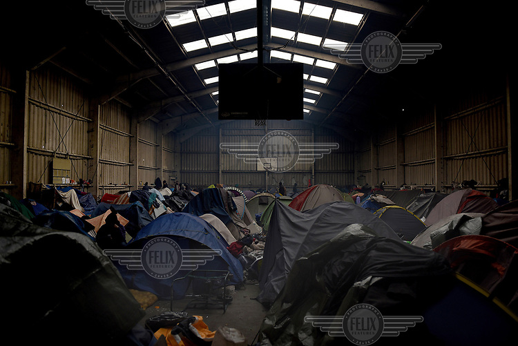 A former basketball court converted into a shelter for the refugees in the camp known as 'The Jungle'.