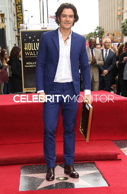 HOLLYWOOD, LOS ANGELES, CA, USA - APRIL 02: Orlando Bloom at Orlando Bloom's star ceremony on the Hollywood Walk of Fame (2,521st star) in the category of Motion Pictures held at 6927 Hollywood Boulevard (next to TCL Chinese Theatre and Madame Tussauds Hollywood) on April 2, 2014 in Hollywood, Los Angeles, California, United States. (Photo by Celebrity Monitor)