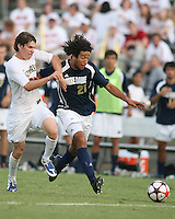 04 September 2009: Justin Morrow #21 of the University of Notre Dame pushes away from Justin Lichtfuss #4 of Wake Forest University during an Adidas Soccer Classic match at the University of Indiana in Bloomington, In. The game ended in a 1-1 tie..