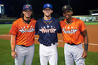 Fort Myers Miracle pitcher Dereck Rodriguez, Dunedin Blue Jays second baseman Cavan Biggio, and Bradenton Maruaders third baseman Ke'Bryan Hayes pose for a photo after the Florida State League All-Star Game on June 17, 2017 at Joker Marchant Stadium in Lakeland, Florida.  FSL North All-Stars  defeated the FSL South All-Stars  5-2.  (Mike Janes/Four Seam Images)