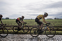 Wout van Aert (BEL/Jumbo-Visma) choosing the muddy grass over the muddy cobbles to move ahead...<br /> <br /> 118th Paris-Roubaix 2021 (1.UWT)<br /> One day race from Compiègne to Roubaix (FRA) (257.7km)<br /> <br /> ©kramon