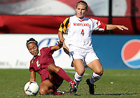 COLLEGE PARK, MD - OCTOBER 21, 2012:  Cory Ryan (4) of the University of Maryland gets the ball away from Ines Jaurena (2) of Florida State during an ACC women's match at Ludwig Field in College Park, MD. on October 21. Florida won 1-0.