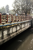 Laboratory assistants from the Institute of Serology collect sewage samples from a sewage in Rabindra Nagar in 24 South Pargana, the outskirts of Kolkata to monitor the polio virus in urban Bengal.