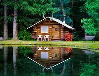 Cabin and reflection in pond at Bear Creek Lodge. Hope, Alaska