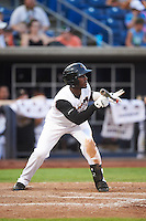 Quad Cities River Bandits designated hitter Hector Roa (15) squares to bunt during a game against the Bowling Green Hot Rods on July 24, 2016 at Modern Woodmen Park in Davenport, Iowa.  Quad Cities defeated Bowling Green 6-5.  (Mike Janes/Four Seam Images)