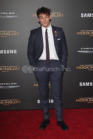 "LOS ANGELES, CA - NOVEMBER 16: Sam Claflin at the Premiere Of ""The Hunger Games: Mockingjay - Part 2"" At Microsoft Theater On November 16, 2015. Credit: mpi21/MediaPunch"