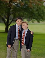 Portrait of two young brothers wearing blue blazers.