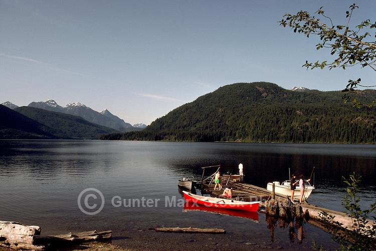 Family enjoying Canoeing (Red Canoe), Boating, and Fishing at Makeshift Dock in Dodd Lake, near Powell River, British Columbia, Canada