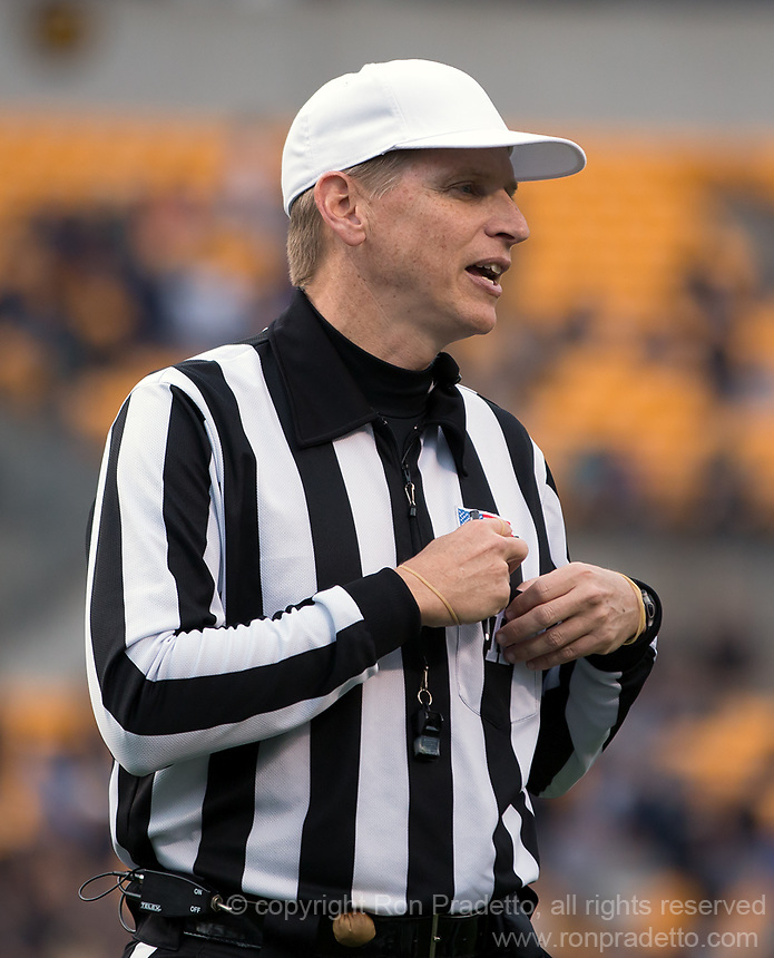 ACC referee Jeff Heaser. The North Carolina Tar Heels defeated the Pitt Panthers 34-27 at Heinz Field, Pittsburgh Pennsylvania on November 16, 2013.