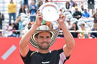 BOGOTÁ -COLOMBIA. 21-07-2013. Alejandro Falla (COL) levanta el trofeo como sub campen del ATP Claro Open Colombia 2013 tras vencer a Ivo Karlovic (CRO) hoy en el Centro de Alto Rendimiento en Bogota./ Alejandro Fall (COL) lifts the trophy as sub champion of ATP Claro Open Colombia 2013 after defeating to Ivo Karlovic (CRO) today in the final at Centro de Alto Rendimiento in Bogota city. Photo: VizzorImage / Str