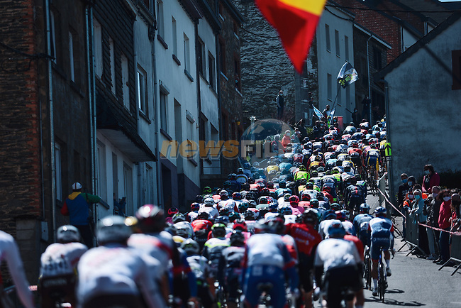 The peloton climb the Cote de Saint Roch in Houffalize during the 107th edition of Liege-Bastogne-Liege 2021, running 259.1km from Liege to Liege, Belgium. 25th April 2021.  <br /> Picture: A.S.O./Aurelien Vialatte   Cyclefile<br /> <br /> All photos usage must carry mandatory copyright credit (© Cyclefile   A.S.O./Aurelien Vialatte)