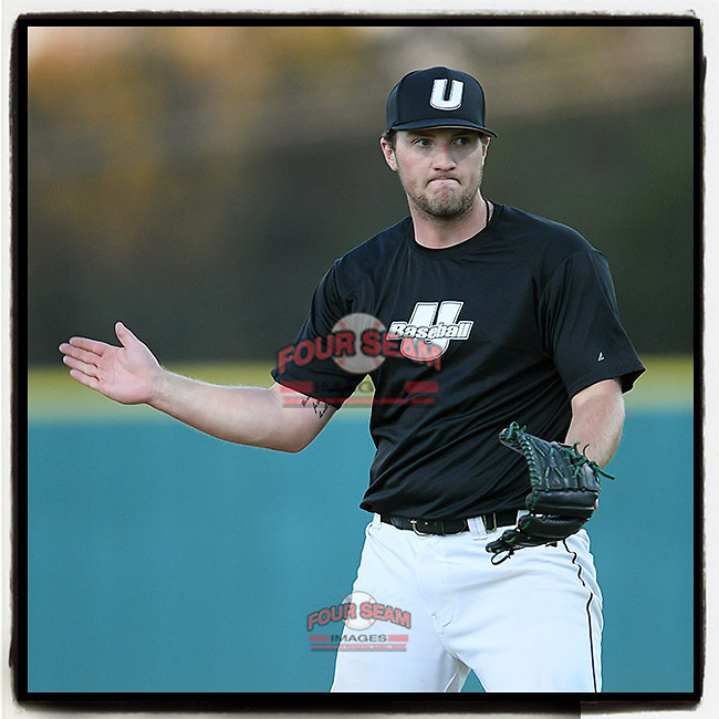 Pitcher Austin Morgan (10) of the University of South Carolina Upstate Spartans Black team pounds his glove after delivering the final pitch in a 2-1 win in the Green and Black Fall World Series Game 1 on Friday, October 30, 2020, at Cleveland S. Harley Park in Spartanburg, South Carolina. (Tom Priddy/Four Seam Images)