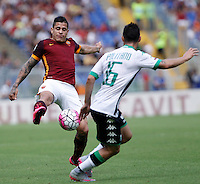 Calcio, Serie A: Roma vs Sassuolo. Roma, stadio Olimpico, 20 settembre 2015.<br /> Roma's Juan Iturbe, left, is challenged by Sassuolo's Matteo Politano during the Italian Serie A football match between Roma and Sassuolo at Rome's Olympic stadium, 20 September 2015.<br /> UPDATE IMAGES PRESS/Isabella Bonotto