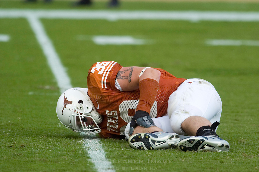 23 September 2006: Texas defensive end Brian Robison clutches his knee after being injured during the Longhorns game against the Iowa State Cyclones at Darrell K Royal Memorial Stadium in Austin, TX.  Robison left the field on a medical cart under the care of team trainers.