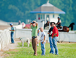 Graham Motion watches as Animal Kingdom, winner of the 137th Kentucky Derby, continues to train for the Belmont Stakes at the Fair Hill Training Center on June 1, 2011 in Fair Hill, Maryland.