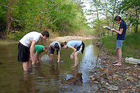 Advanced Placement High school Environmental Science students conducting filed research on a nearby creek.  Testing includes chemistry, biology and geology of the stream...