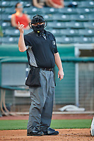 Umpire Tom Woodring handles the calls behind the plate during the game between the Salt Lake Bees and the Tacoma Rainiers at Smith's Ballpark on May 13, 2021 in Salt Lake City, Utah. The Rainiers defeated the Bees 15-5. (Stephen Smith/Four Seam Images)