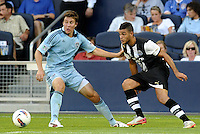 Newcastle United midfielder Hatem Ben Arfa looking at passing the ball past Sporting KC defender Matt Besler... Sporting Kansas City and Newcastle United played to a 0-0 tie in an international friendly at LIVESTRONG Sporting Park, Kansas City, Kansas.