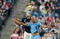FOXBOROUGH, MA - SEPTEMBER 29: Antonio Mlinar Delamea #19 of New England Revolution andHeber #9 of New York City FC battle for head ball during a game between New York City FC and New England Revolution at Gillette Stadium on September 29, 2019 in Foxborough, Massachusetts.