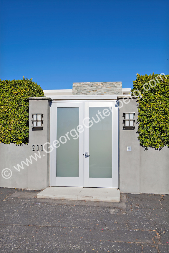Double glass doors lead to entryway