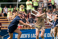 NEWTON, MA - MAY 22: Charlotte North #8 of Boston College on the attack as Diana Kelly #12 of Notre Dame defends during NCAA Division I Women's Lacrosse Tournament quarterfinal round game between Notre Dame and Boston College at Newton Campus Lacrosse Field on May 22, 2021 in Newton, Massachusetts.