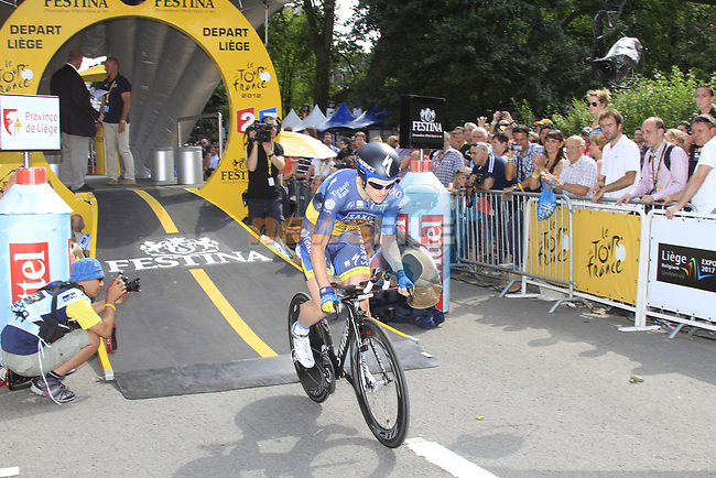 Nick Nuyens (BEL) Saxo Bank-Tinkoff Bank powers down the start ramp during the Prologue of the 99th edition of the Tour de France 2012, a 6.4km individual time trial starting in Parc d'Avroy, Liege, Belgium. 30th June 2012.<br /> (Photo by Eoin Clarke/NEWSFILE)