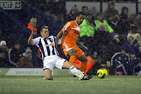 Pictured: Wayne Routledge (R) tackled by Nicky Shorey of West Bromwich. Saturday, 04 February 2012<br /> Re: Premier League football, West Bromwich Albion v Swansea City FC v at the Hawthorns Stadium, Birmingham, West Midlands.