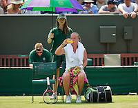 England, London, June 30, 2015, Tennis, Wimbledon, Richel Hogenkamp (NED) drinks and has a wet towel in her nek to stay cool<br /> Photo: Tennisimages/Henk Koster