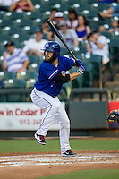Round Rock Express designated hitter Bryan Petersen (7) at bat during the Pacific Coast League baseball game against the Omaha Storm Chasers on June 1, 2014 at the Dell Diamond in Round Rock, Texas. The Express defeated the Storm Chasers 11-4. (Andrew Woolley/Four Seam Images)