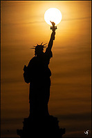 Statue of Liberty and rising Sun.