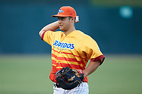 Justin Yurchak (33) of the Los Rapidos de Kannapolis warms up in the outfield prior to the game against the West Virginia Power at Kannapolis Intimidators Stadium on July 25, 2018 in Kannapolis, North Carolina. The Los Rapidos defeated the Power 8-7 in game two of a double-header. (Brian Westerholt/Four Seam Images)