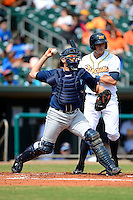 Mobile BayBears catcher Humberto Cota #20 throws down to second in front of outfielder Mikie Mahtook #8 at bat during a game against the Montgomery Biscuits on April 16, 2013 at Riverwalk Stadium in Montgomery, Alabama.  Montgomery defeated Mobile 9-3.  (Mike Janes/Four Seam Images)