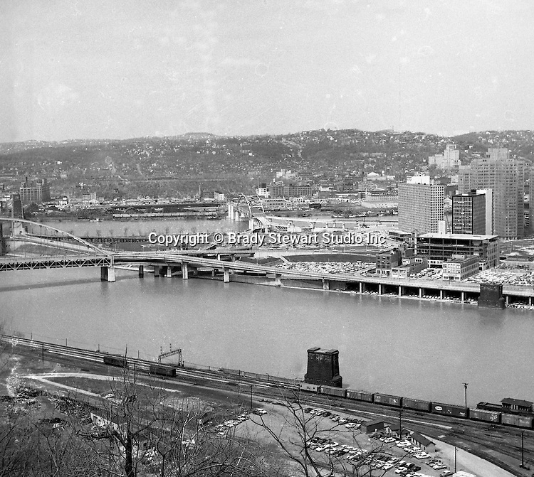 Pittsburgh PA:  View of the city's skyline.  View includes Gateway Center and construction of the Pittsburgh Press Building.  View also includes the clearing of the Point and the Fort Duquesne Bridge and ramp construction.
