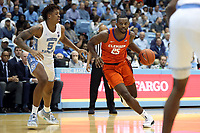CHAPEL HILL, NC - JANUARY 11: Aamir Simms #25 of Clemson University drives past Armando Bacot #5 of the University of North Carolina during a game between Clemson and North Carolina at Dean E. Smith Center on January 11, 2020 in Chapel Hill, North Carolina.