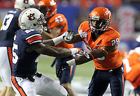 ATLANTA, GA - DECEMBER 31: Anthony Harris #28 of the Virginia Cavaliers blocks Daren Bates #25 of the Auburn Tigers during the 2011 Chick Fil-A Bowl at the Georgia Dome on December 31, 2011 in Atlanta, Georgia. Auburn defeated Virginia 43-24. (Photo by Andrew Shurtleff/Getty Images) *** Local Caption *** Anthony Harris;Daren Bates