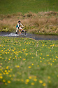 19/04/18<br /> <br /> On the hottest day of the year, Chloé Kirkpatrick, 25, cools off as she rides her bicycle through Tissington ford near Ashbourne in the Derbyshire Peak District.<br /> <br /> All Rights Reserved: F Stop Press Ltd. +44(0)1335 344240  www.fstoppress.com.
