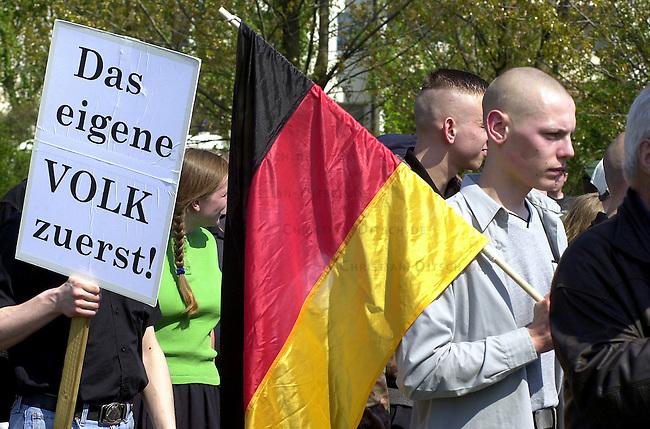 """Ca. 700 Mitglieder und Sympathiesanten der rechtsextremistischen NPD demonstrierten am 1. Mai 2001 im Berliner Bezirk Hohenschoenhausen. Die Demonstration wurde nach einem Verbot durch den Innensenator Werthebach von den Berliner Gerichten erlaubt. Der Aufzug wurde von einem starken Polizeiaufgebot begleitet. Gegendemonstranten wurden abgedraengt und zum Teil verhaftet.<br /> 1.5.2001, Berlin<br /> Copyright: Christian-Ditsch.de<br /> [Inhaltsveraendernde Manipulation des Fotos nur nach ausdruecklicher Genehmigung des Fotografen. Vereinbarungen ueber Abtretung von Persoenlichkeitsrechten/Model Release der abgebildeten Person/Personen liegen nicht vor. NO MODEL RELEASE! Nur fuer Redaktionelle Zwecke. Don't publish without copyright Christian-Ditsch.de, Veroeffentlichung nur mit Fotografennennung, sowie gegen Honorar, MwSt. und Beleg. Konto: I N G - D i B a, IBAN DE58500105175400192269, BIC INGDDEFFXXX, Kontakt: post@christian-ditsch.de<br /> Bei der Bearbeitung der Dateiinformationen darf die Urheberkennzeichnung in den EXIF- und  IPTC-Daten nicht entfernt werden, diese sind in digitalen Medien nach §95c UrhG rechtlich geschuetzt. Der Urhebervermerk wird gemaess §13 UrhG verlangt.]<br /> <br /> 700 members of the far rightwing Nationaldemokratic Party Deutschland (NPD) are  marching with heavy protection by the Berlin Police through the Suburb Hohenschoenhausen.Protest agaist the Demonstration of the NPD was banned by the Police Authorities, only a few protestors were able to cross the heavy police cordon.<br /> On the sign: """"The own nation first"""".<br /> 1.5.2001, Berlin<br /> Copyright: Christian-Ditsch.de<br /> [Inhaltsveraendernde Manipulation des Fotos nur nach ausdruecklicher Genehmigung des Fotografen. Vereinbarungen ueber Abtretung von Persoenlichkeitsrechten/Model Release der abgebildeten Person/Personen liegen nicht vor. NO MODEL RELEASE! Nur fuer Redaktionelle Zwecke. Don't publish without copyright Christian-Ditsch.de, Veroeffentlichung nur mit Fotografenn"""