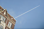 Brick Apartment Building with Blue Skies