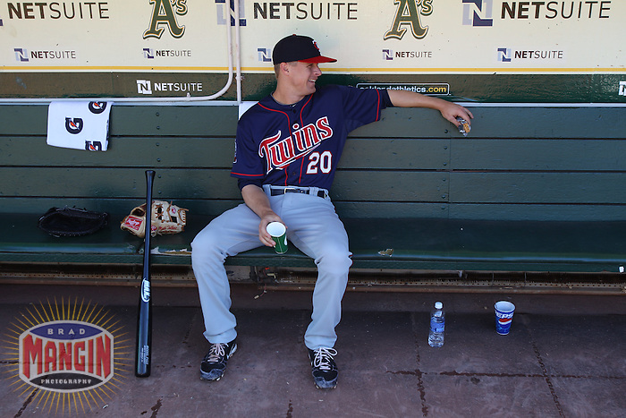OAKLAND, CA - JUNE 5:  Matt Tolbert #20 of the Minnesota Twins gets ready in the dugout before the game against the Oakland Athletics at the Oakland-Alameda County Coliseum on June 5, 2010 in Oakland, California. Photo by Brad Mangin