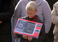 Pictured: A young boy with an album with pictures from the time at the Memorial Garden in Aberfan Friday 21 October 2016<br />