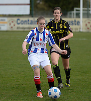 20140315 - WESTERLO , BELGIUM : Heerenveen Sisca Folktersma (l) pictured in front of Lierse  Evelien Stoffels during the soccer match between the women teams of SK Lierse Dames  and SC Heerenveen Vrouwen , on the 19th matchday of the BeNeleague competition Saturday 15 March 2014 in Westerlo . PHOTO DAVID CATRY