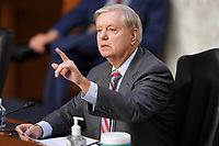 United States Senator Lindsey Graham (Republican of South  Carolina), Chairman, US Senate Judiciary Committee during a business meeting prior to the fourth day for the confirmation hearing of President Donald Trump's Supreme Court nominee Judge Amy Coney Barrett on Thursday, October 15, 2020.<br /> Credit: Greg Nash / Pool via CNP /MediaPunch