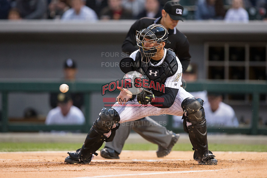 Charlotte Knights catcher Kevan Smith (32) fields a throw at home plate during the game against the Scranton\Wilkes-Barre RailRiders at BB&T BallPark on May 1, 2015 in Charlotte, North Carolina.  The RailRiders defeated the Knights 5-4.  (Brian Westerholt/Four Seam Images)