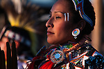 A woman dances during an intertribal dance during the evening powwow at Crow Fair.