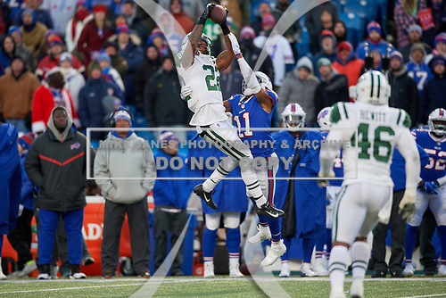 New York Jets defensive back Trumaine Johnson (22) intercepts a pass over wide receiver Zay Jones (11) during an NFL football game against the Buffalo Bills, Sunday, December 9, 2018, in Orchard Park, N.Y.  (Mike Janes Photography)