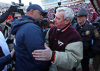 Nov 27, 2010; Charlottesville, VA, USA;  Virginia Tevch head coach Frank Beamer, right, shakes hands with Virginia Cavaliers head coach Mike London after the game at Lane Stadium. Virginia Tech won 37-7. Mandatory Credit: Andrew Shurtleff-