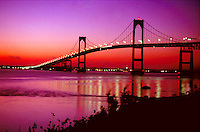 Newport Bridge is silhouetted against a colorful Rhode Island sunrise