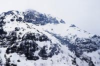 Mount Yake (Yake-dake) under snow in early spring in Japan.